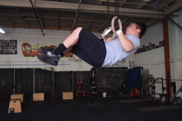 """During """"Nate"""" Jeff gets another muscle up while Karen does handstand push ups"""
